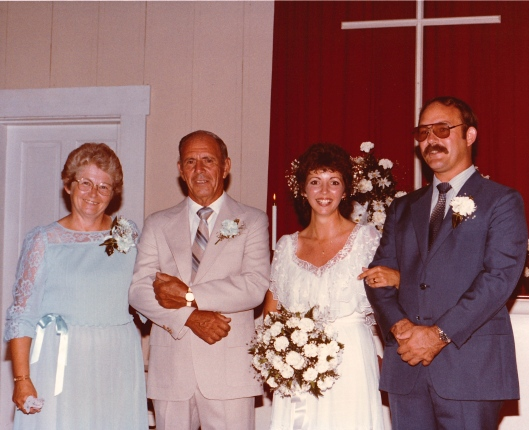 My parents and us at the church