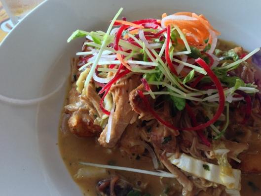 Slow roasted pork, on potato dumplings with shredded fresh veg on top - delicious! Robe Pub, Robe SA