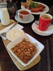 Homemade granola served with honey yogurt/plus hubby had homemade baked beans, bacon and thick rye and wheat toast. SO delicious-Wild Mulberry Cafe, Robe SA