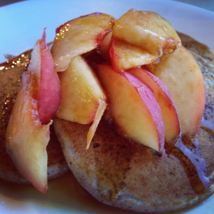 Buckwheat Pikelets with white peaches and maple syrup