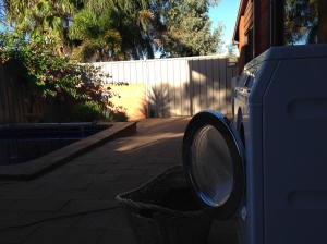 Temporarily repositioned washing machine-outside