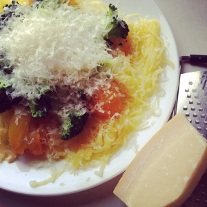 Spaghetti squash with butter, salt, pepper, lightly cooked yellow cherry tomatoes, broccoli and Parmesan