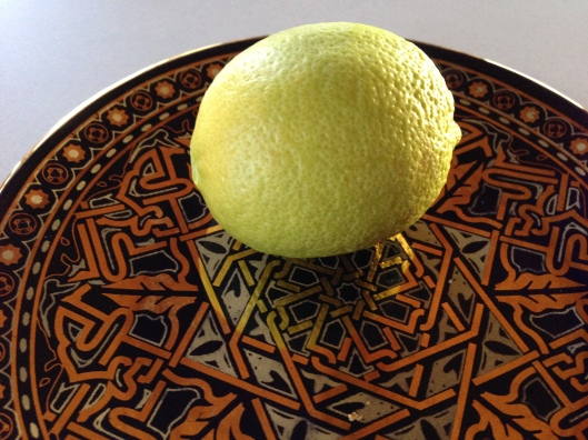 Lemon on plate with Moorish design