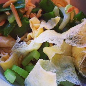 stir-fried celery, snow peas and almonds with egg ribbons