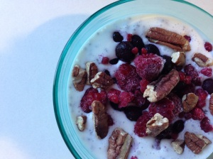 Coconut milk with chia seeds, pecans and berries