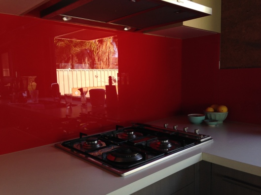Outside reflection in red glass splash back