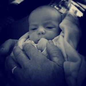 Newest grandchild in his Grandpa's hands