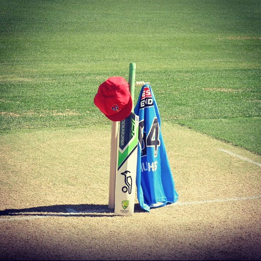 The photo taken by SACA of the memorial bat and hat and retired #64 shirt