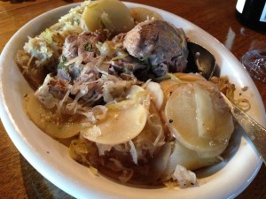 Pork scotch fillet with potato, sauerkraut and cabbage