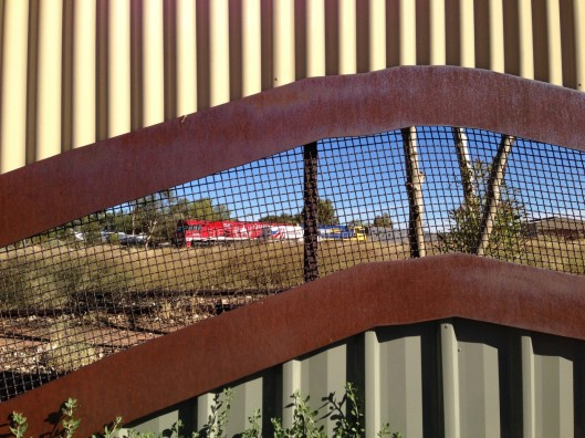 Peeking through the fence at the Ghan in Alice railyard