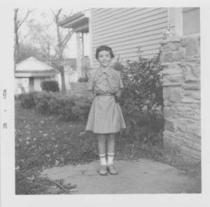 Age 9, Brownie Uniform geekiness (feature fossil wall beside)