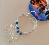 Sterling silver daisies on hoops with Swarovski crystal