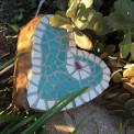 Mosaic heart shaped rock