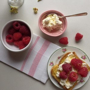 homemade ricotta with raspberries and hone on gluten free pumpkin bread