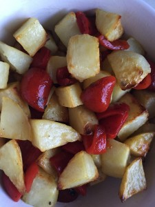 Roasted potatoes with roasted pepper pieces