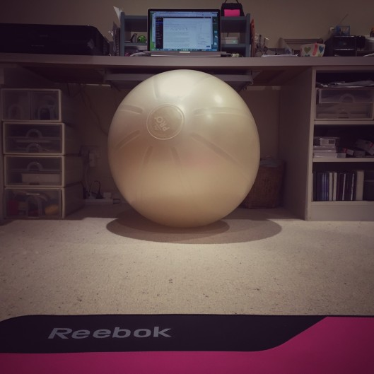 Gym ball doubles as office chair, floor doubles as exercise studio