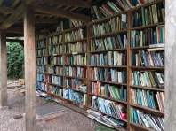 Undercover on the grounds of the Hay Cathedral under renovation, were two of these walls of books, donated and then newly acquired for the small some of £2 deposited into the church collection box.